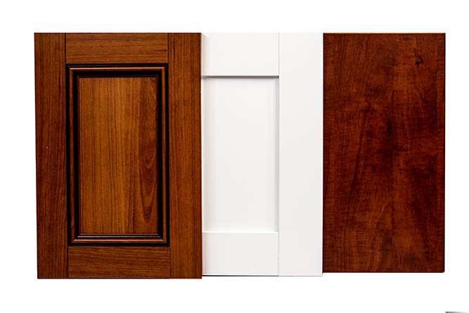 Three cabinet doors overlapping one another.