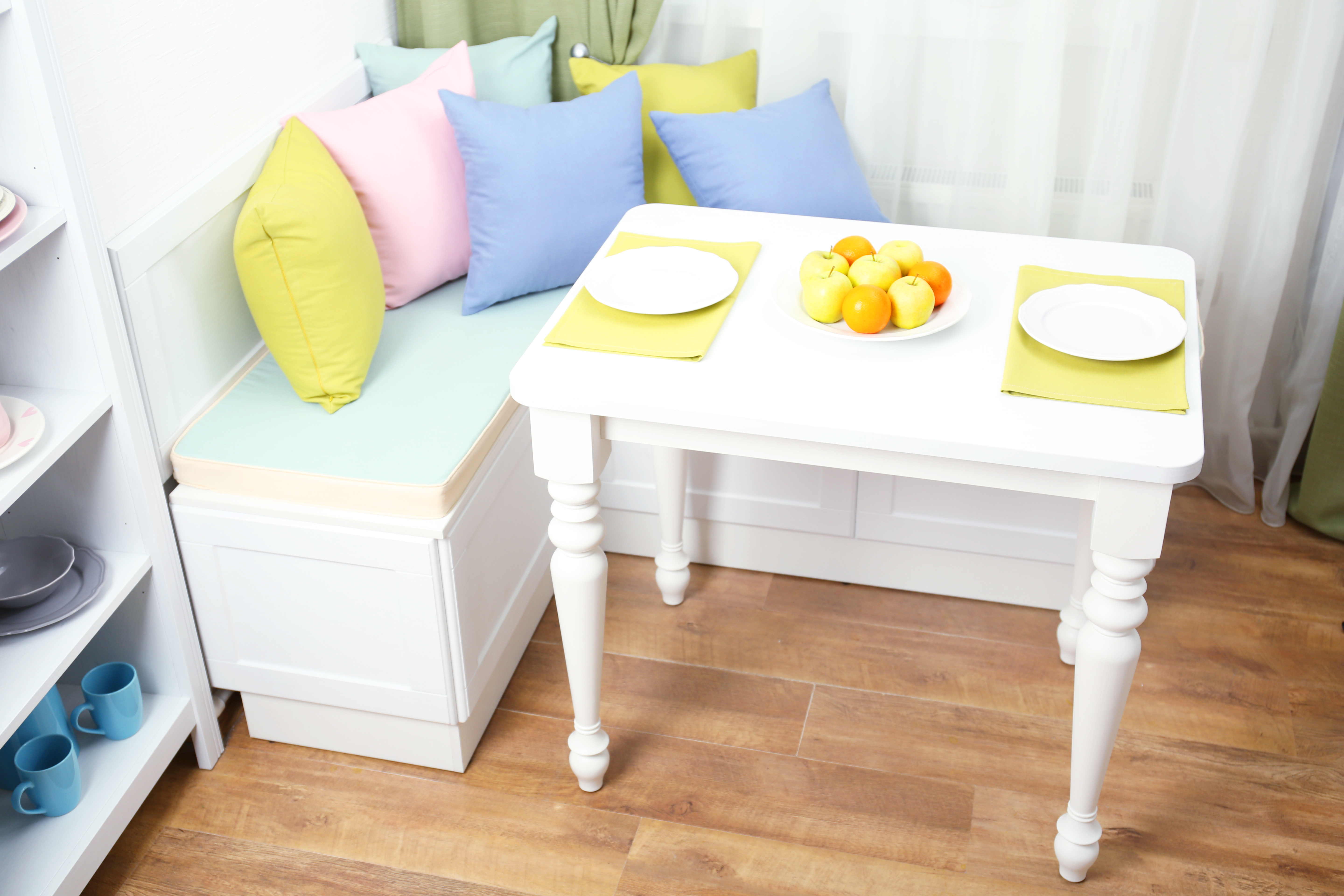A built-in breakfast nook with a table.