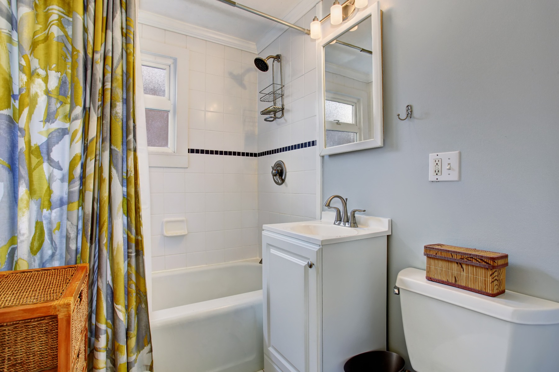 A bathroom with a colorful shower curtain.