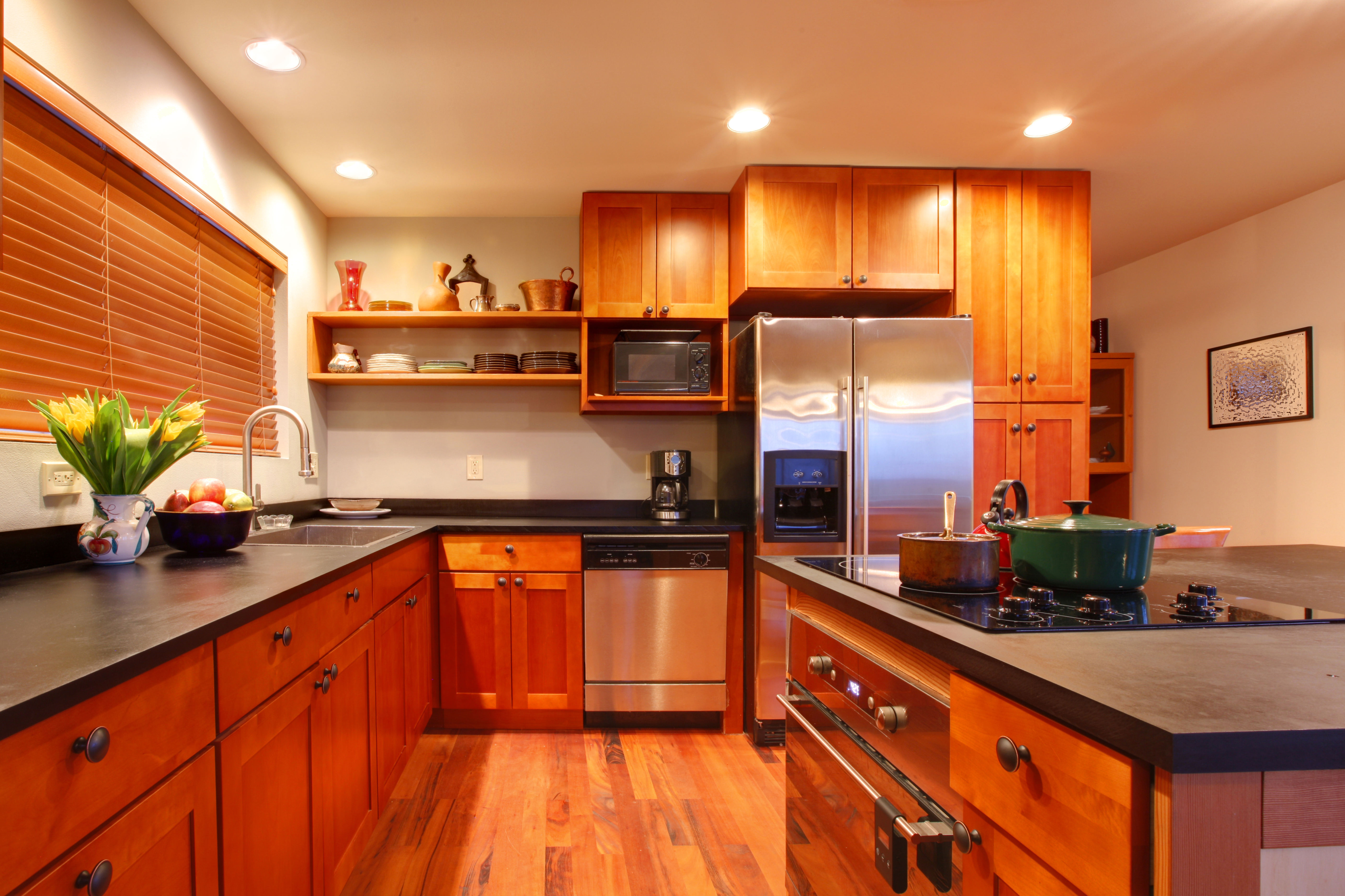 A kitchen with solid wood, traditional shaker cabinets