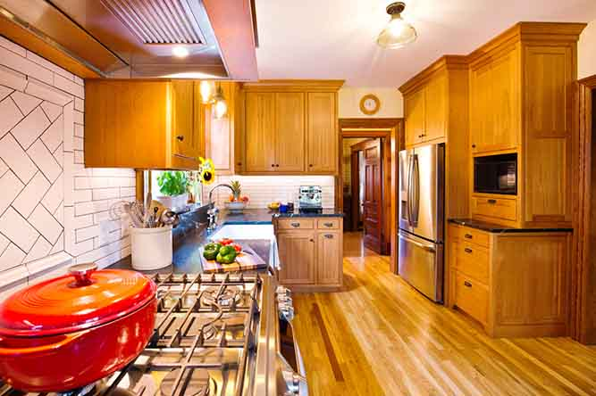 A large kitchen with traditionally styled cabinets in a cherry finish.