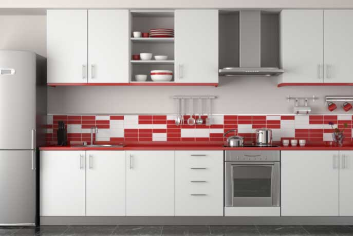 A modern, white kitchen with slab-style cabinets.